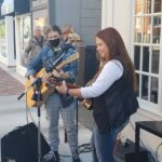 2 People playing music on guitars at Export Grill Belleville